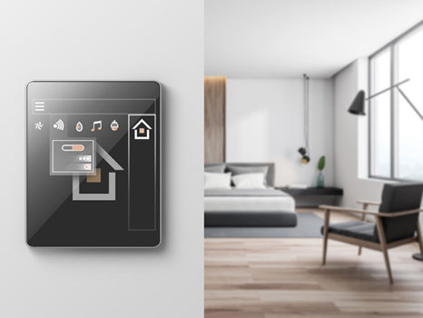 Smart home icons on tablet computer in modern bedroom with white walls, wooden floor, king size bed and armchair. Concept of automation. 3d rendering blurred